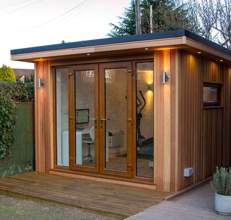 Penrhyn home improvements specialises in outbuildings for Cedar clad garage doors